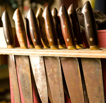 Chef knives in rack-- Kramer knives.